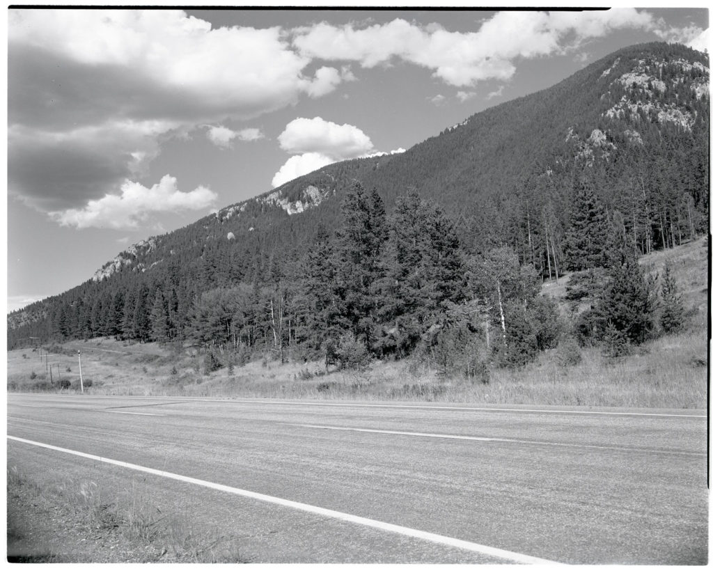 A view from the same hillside, now located just off the highway. Date: 07/21/1981 Credit: George Gruell (USFS) Archived at the Mansfield Library at the University of Montana
