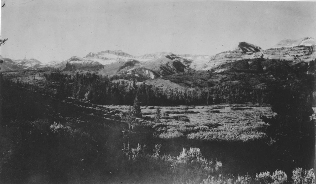 Doubletop, Hodges, and Eagle Peaks from the south. This is the same photo point as the previous photo pair, but a different angle. Date: 07/02/1911 Credit: Elliot Blackwelder, Archived at the University of Wyoming American Heritage Center