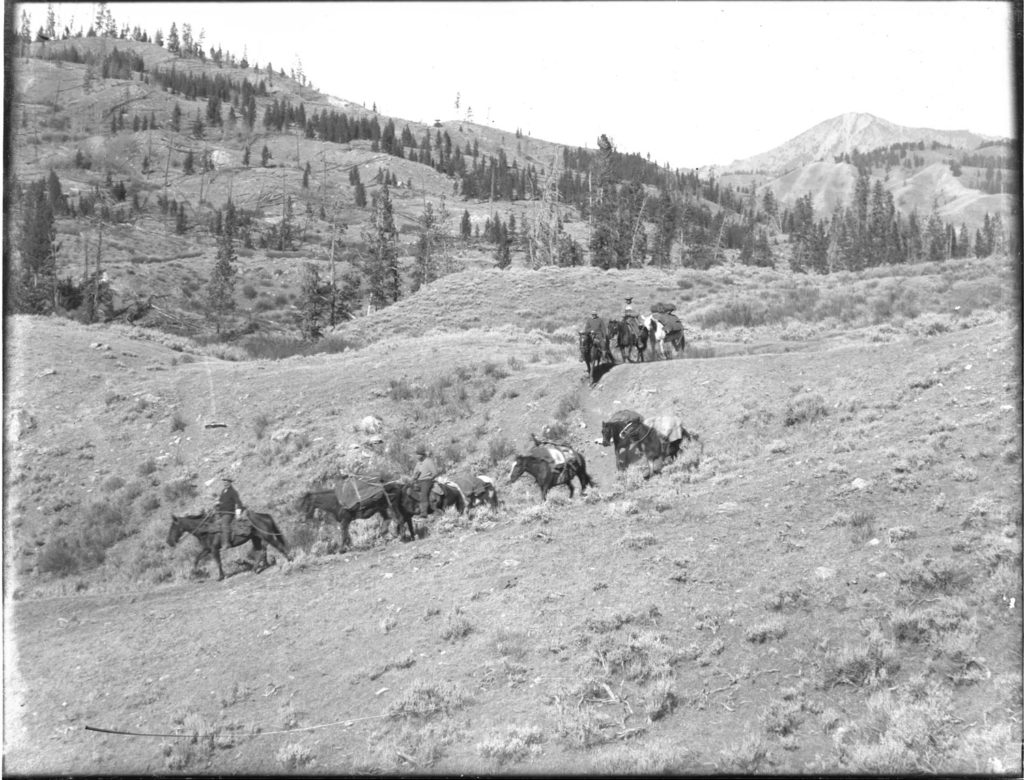 A hunting party rides over a sagebrush covered hill in the Slate Creek valley, Wyoming. Date: Around 1905 Credit: Stephen Leek, Archived at the University of Wyoming American Heritage Center