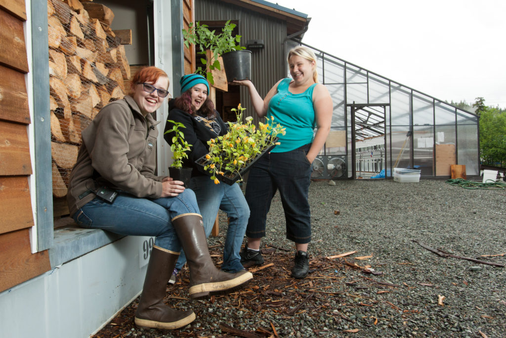 Students on Prince of Wales Island show off vegetable starts grown in wood-fired greenhouse.