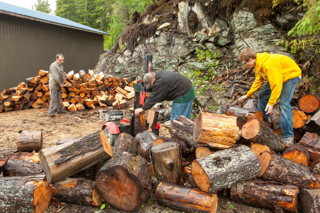Students earn money by splitting and stacking wood to heat the schools. Across Prince of Wales the switch to wood heat has created six part-time jobs. Photo: Dan Bihn