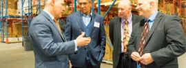 EPA Administrator Scott Pruitt, left, talks with industry representatives at a private tour of Central Paper Products